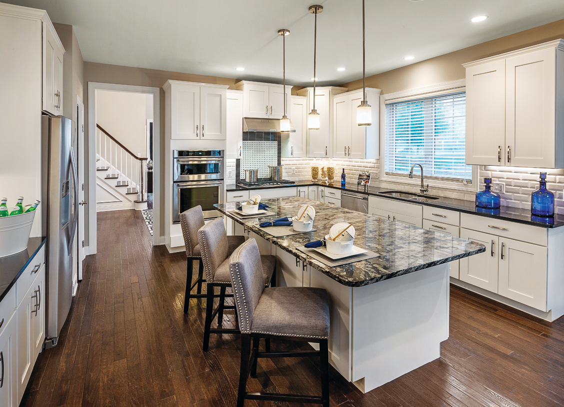 The Brandeis kitchen with center island open to great room