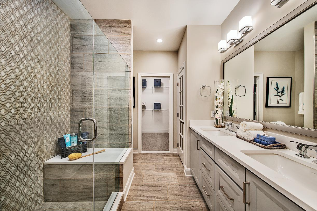 Primary bathroom with large shower and dual vanity