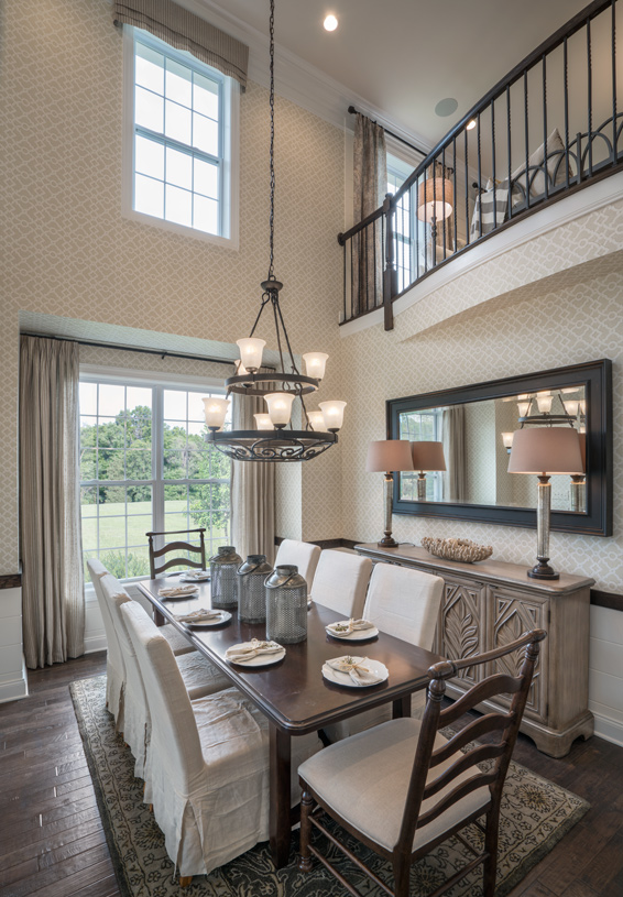 Two-story dining room with upscale finishes