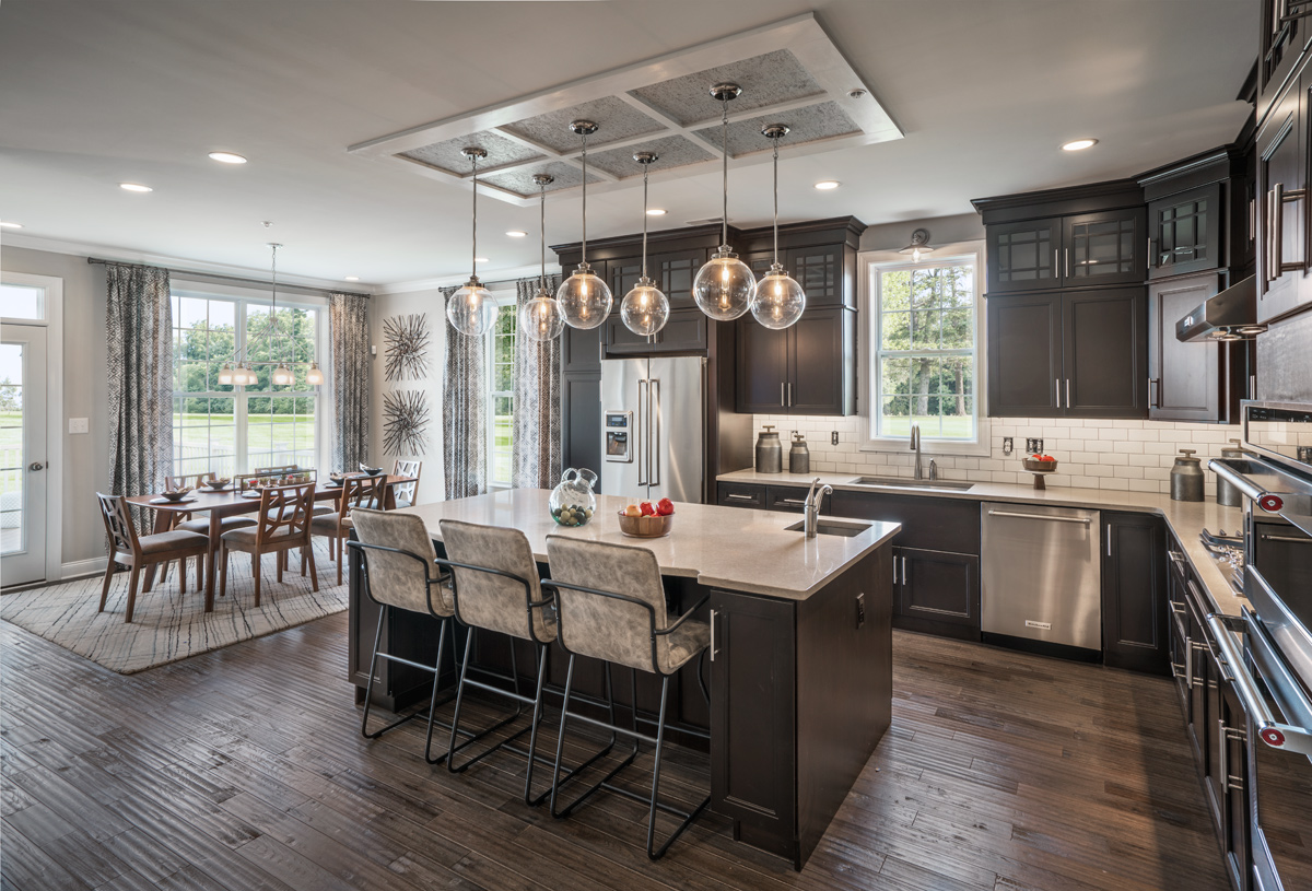 Well-appointed Delancy kitchen is adjacent to the sunlit casual dining area