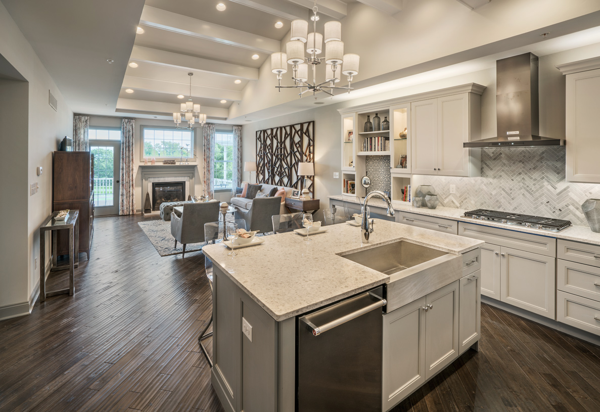 Large island in state-of-the-art kitchen overlooks the great room