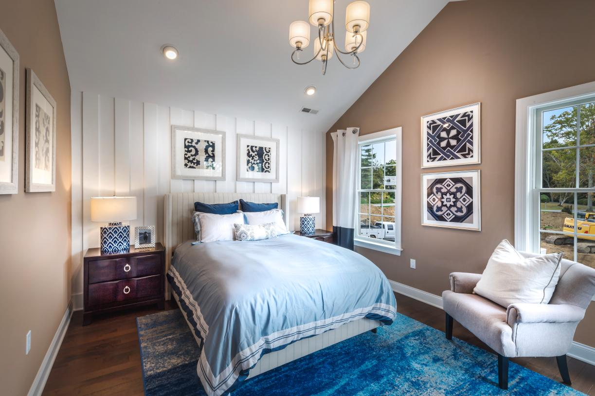 Roomy secondary bedroom with cathedral ceiling