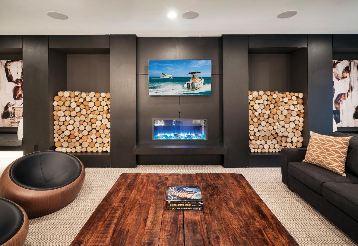 Lounge with linear fireplace in lower level