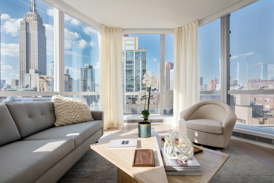 Floor To Ceiling Windows Allow For Light Filled Living Spaces With Breathtaking Views Of Manhattan
