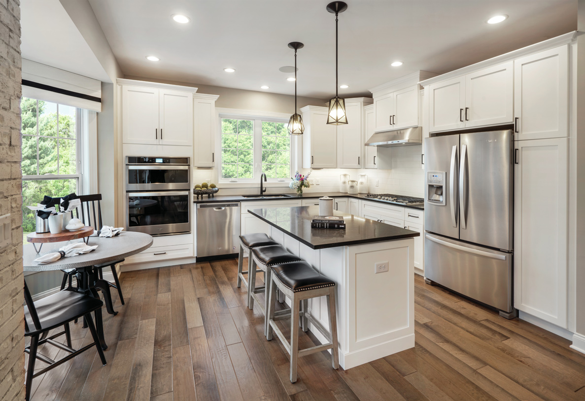 Kitchen with center island and well-lit casual dining nook