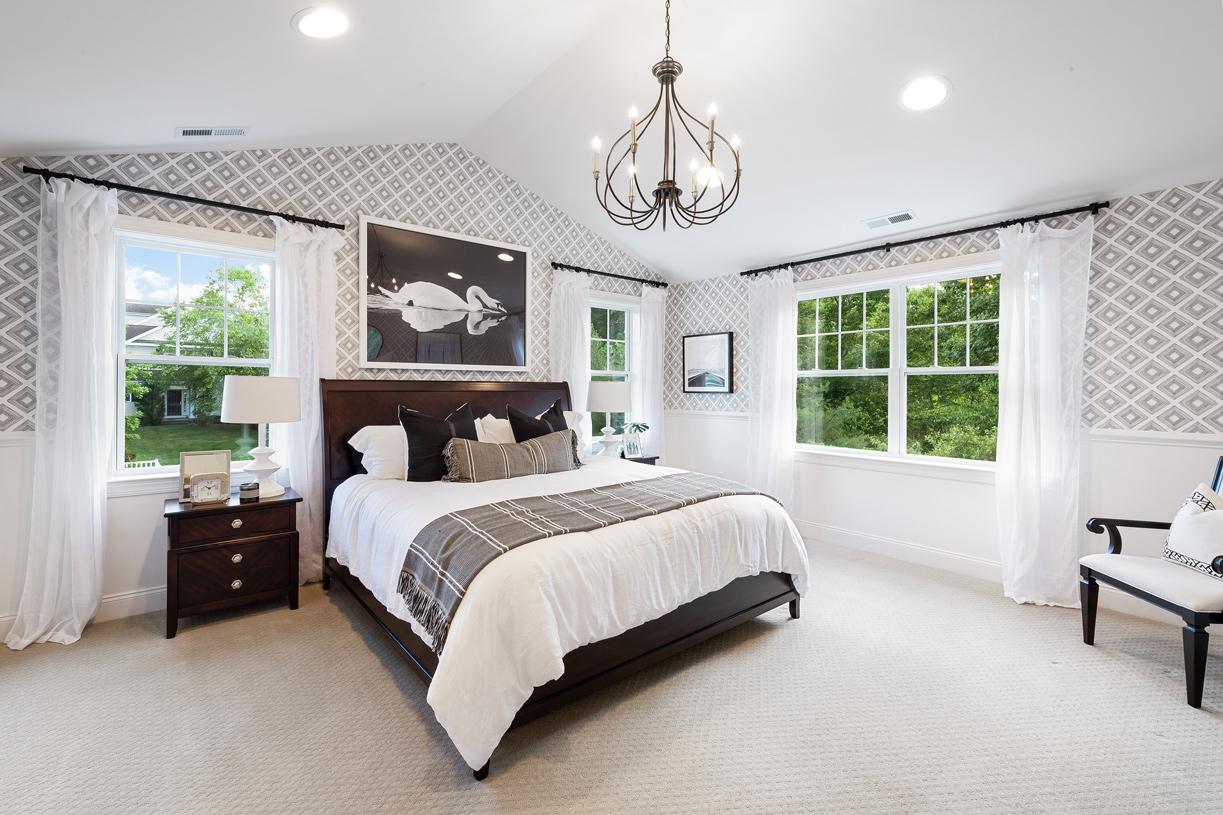 Luxurious primary bedroom suite in the Denton model