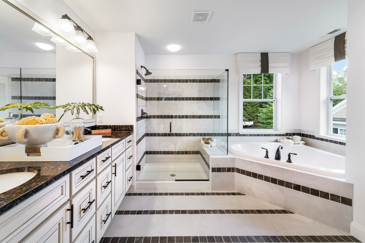 Primary bathroom suite with dual-vanity and tub