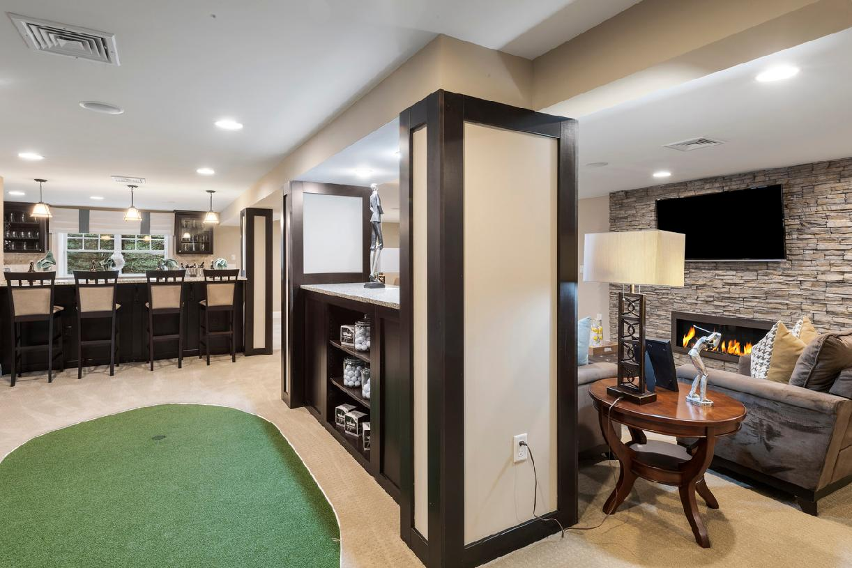 Finished basement with built-in bar and putting green