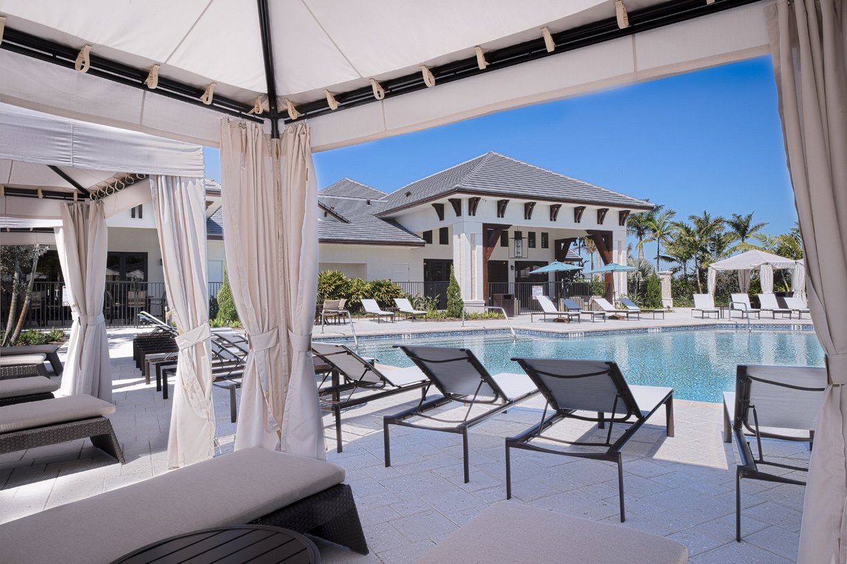 Residents enjoy the resort-style swimming pool and cabanas