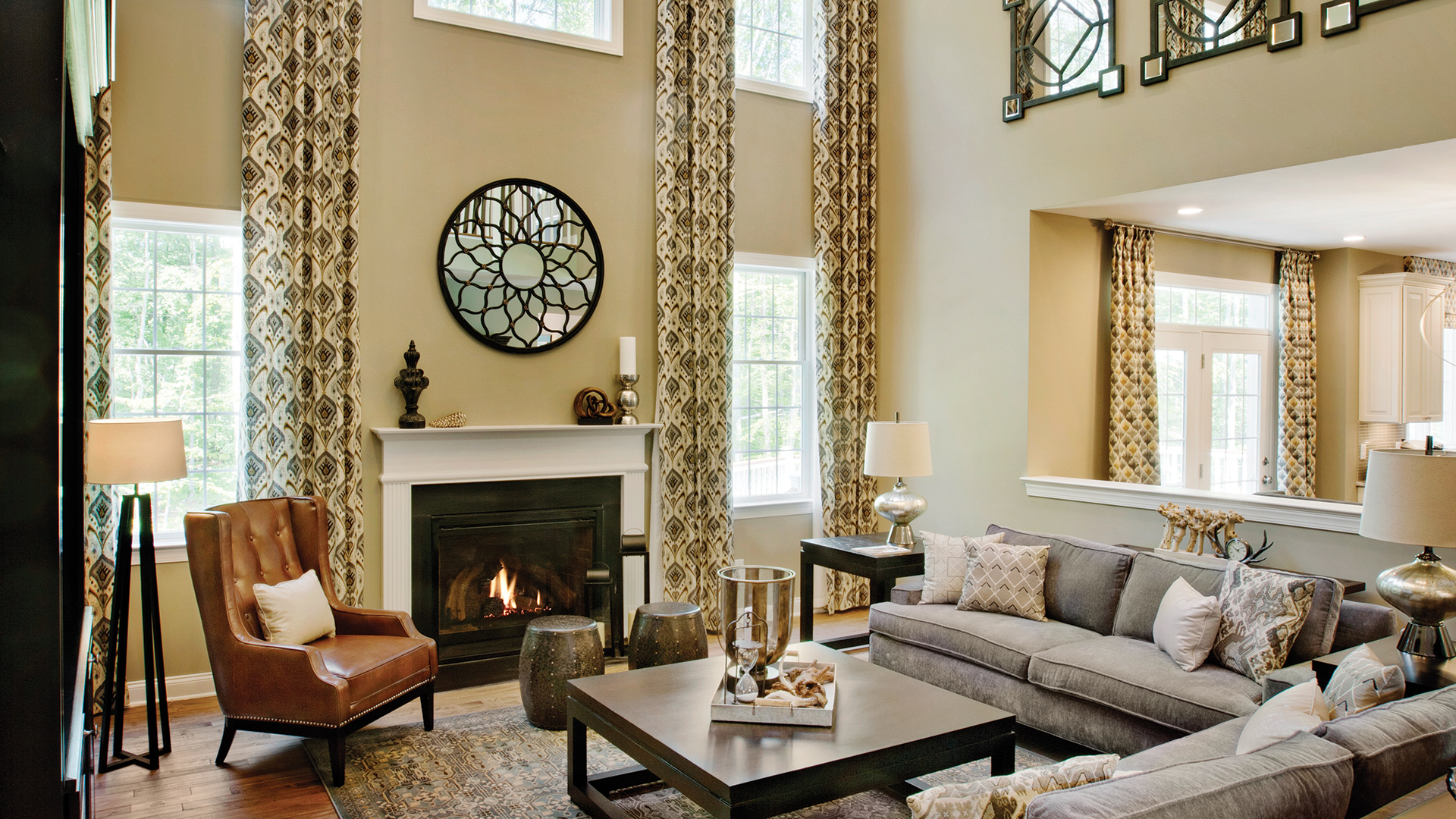 Two-Story Family Room with Fireplace and Wall of Windows
