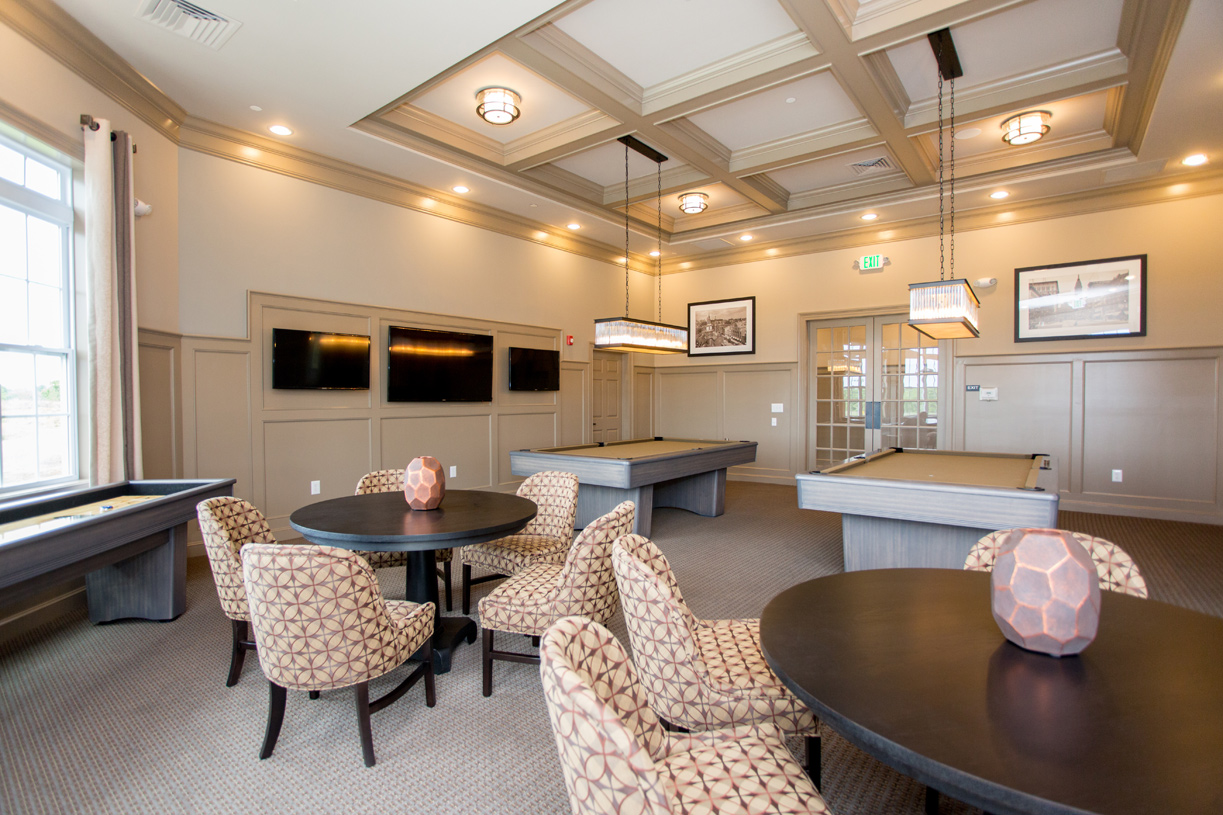 The game room features billiards, shuffleboard, and tables for playing cards or board games