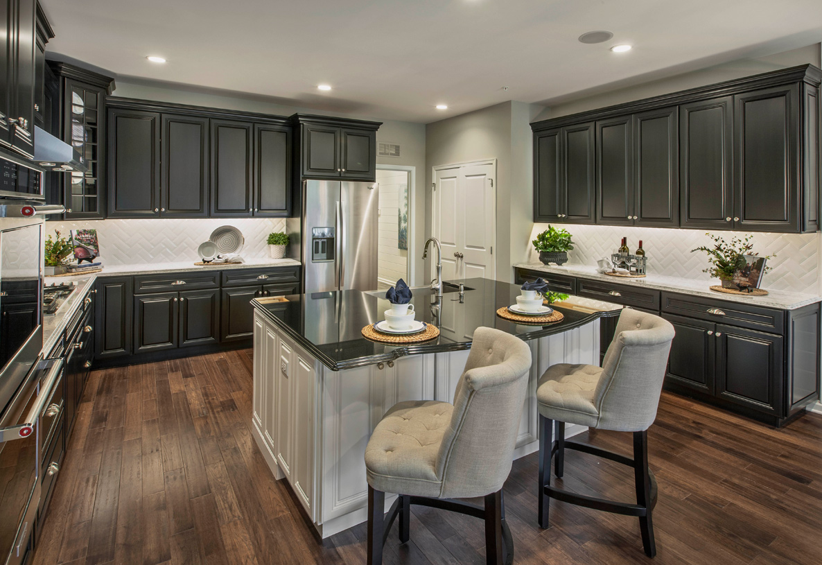 Well-appointed kitchens with stainless steel appliances and granite countertops