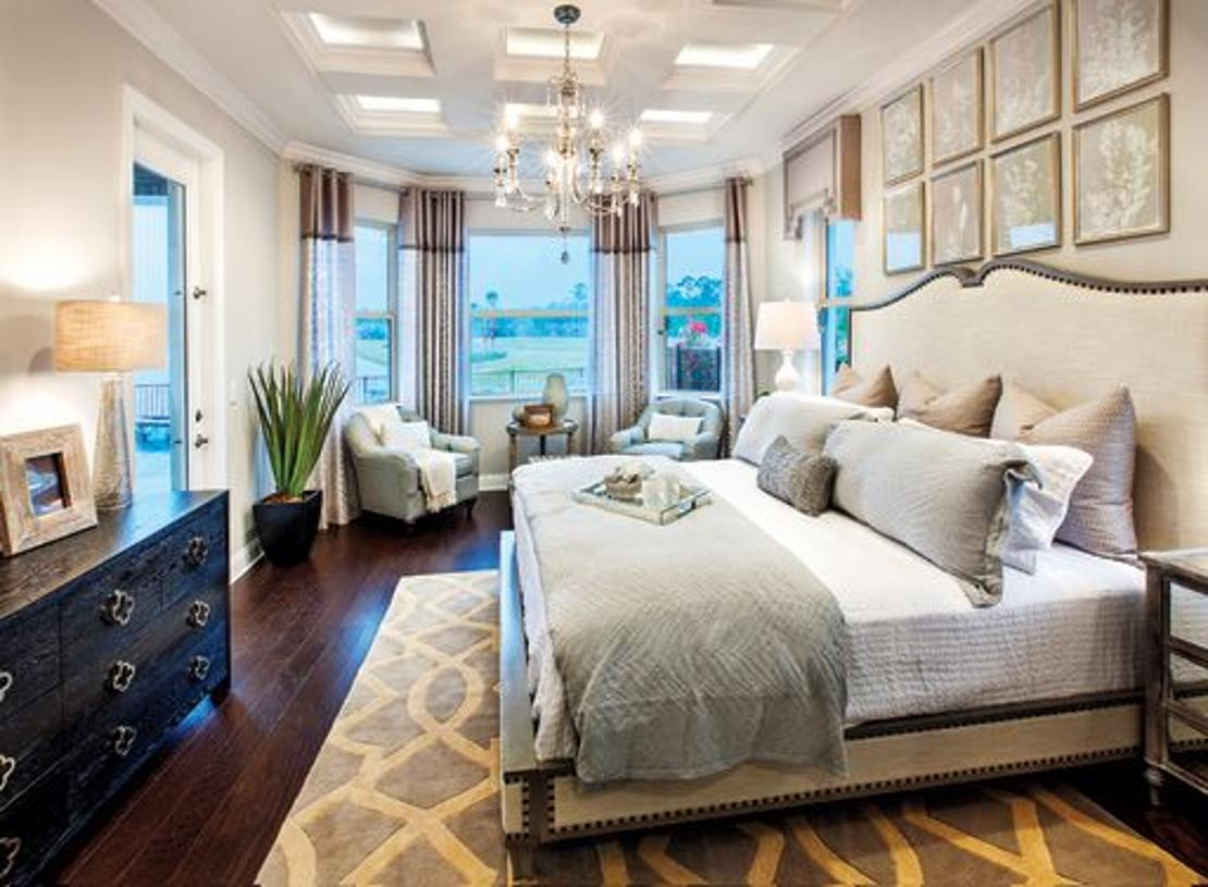 Luxurious primary suite with bay window (model photo)