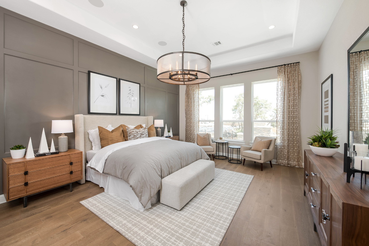 Spacious Artisan primary bedroom with tray ceiling