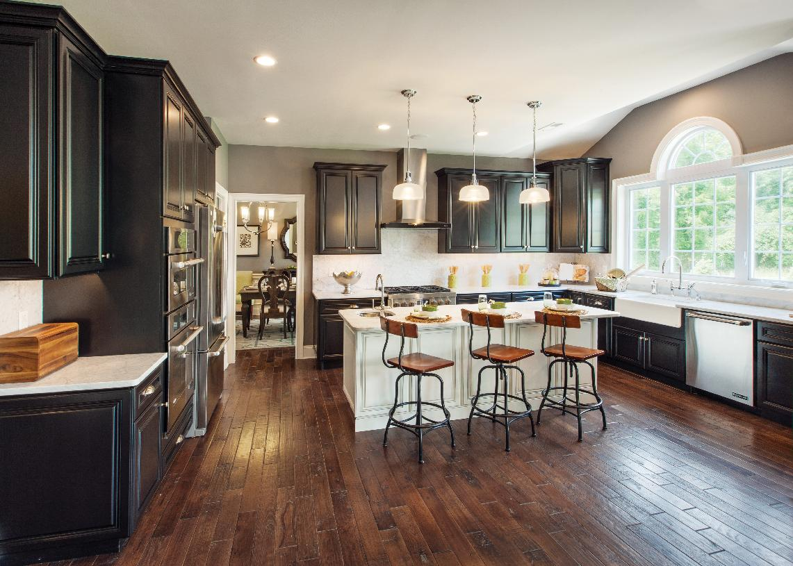 Gourmet kitchen also includes Whirlpool® stainless steel appliances, granite countertops, hardwood flooring, and more