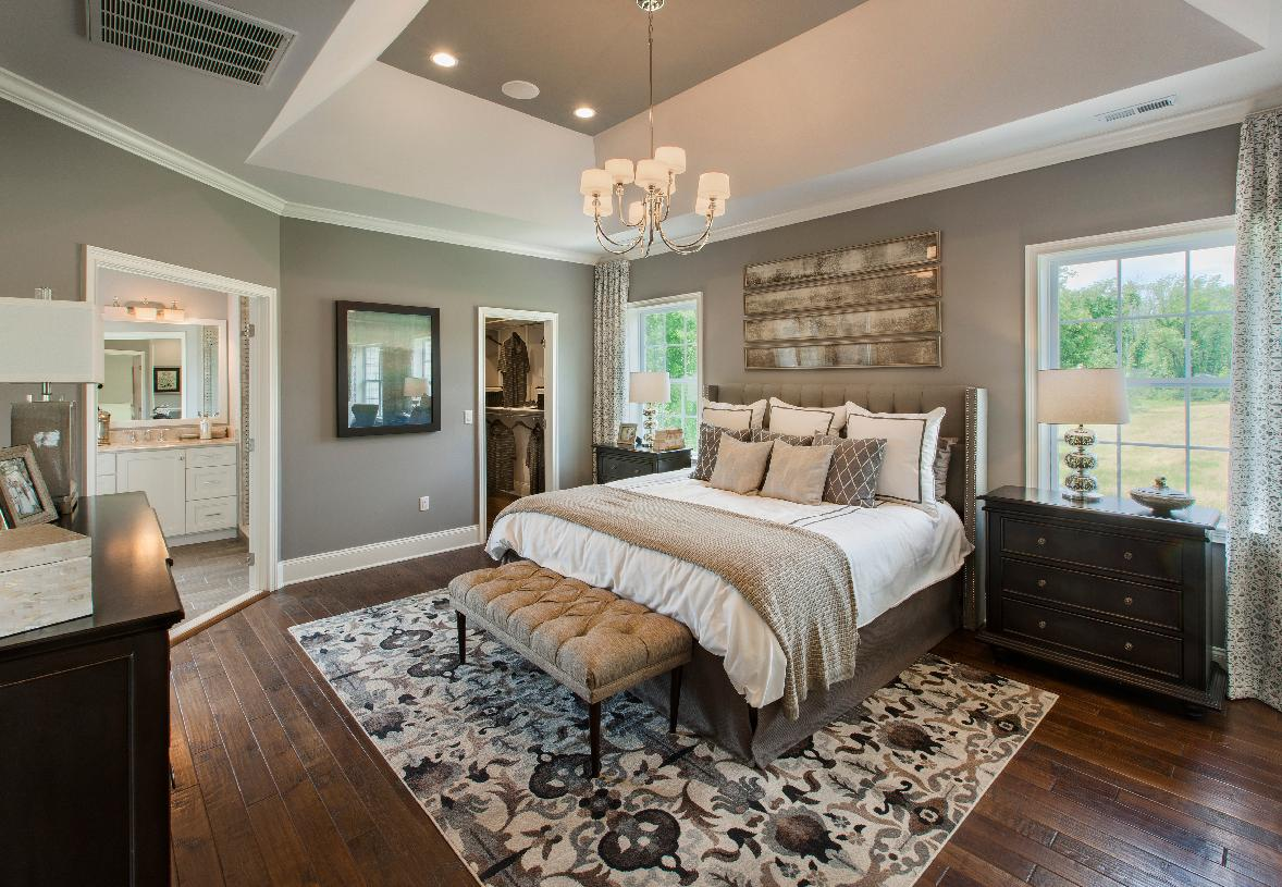 Luxurious primary bedroom suite with two large walk-in closets