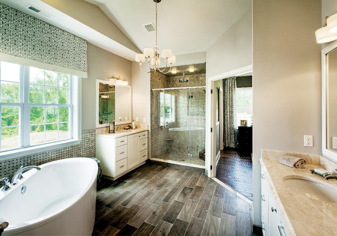 Sumptuous primary bath with lavish appointments