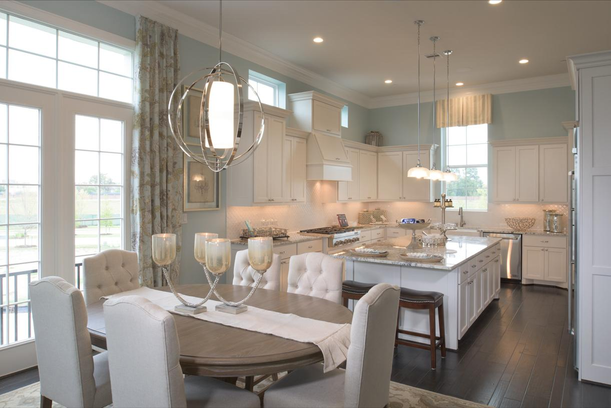 Dining space sits between kitchen and great room