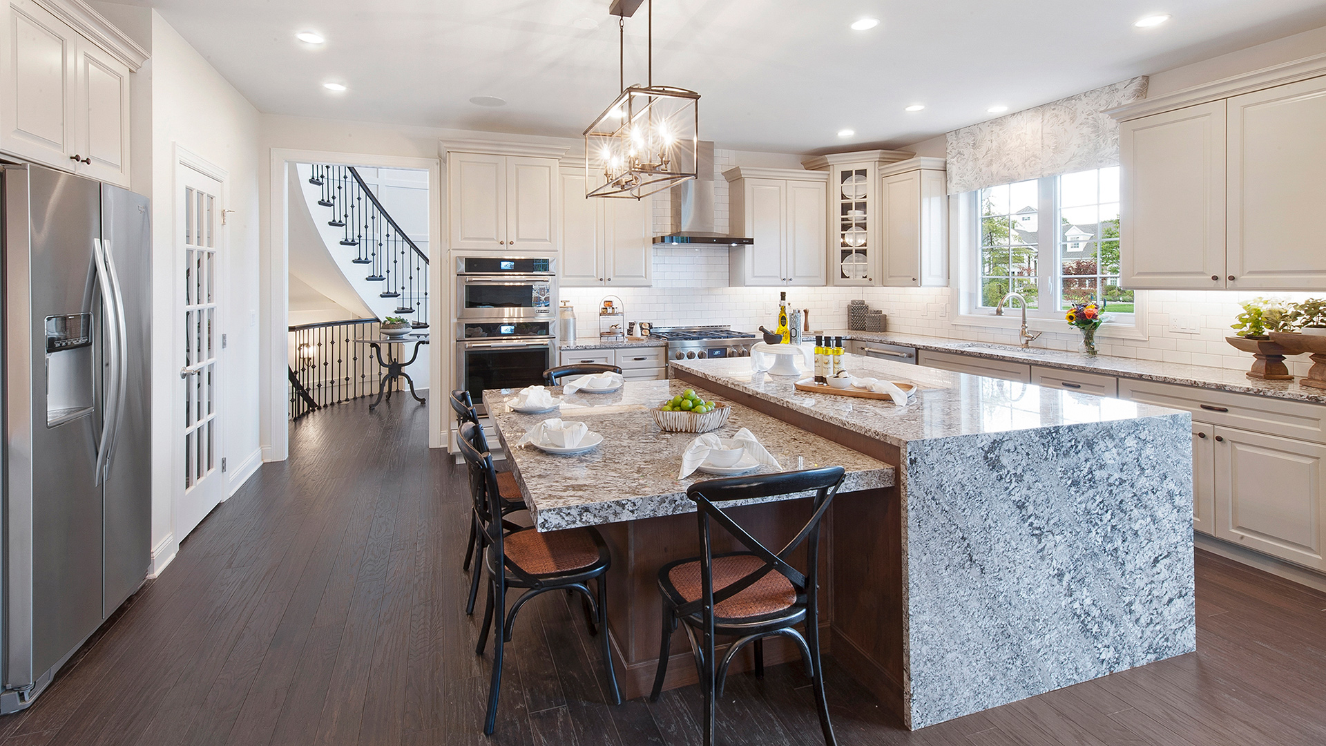 The stylish kitchen features name-brand appliances and granite countertops.