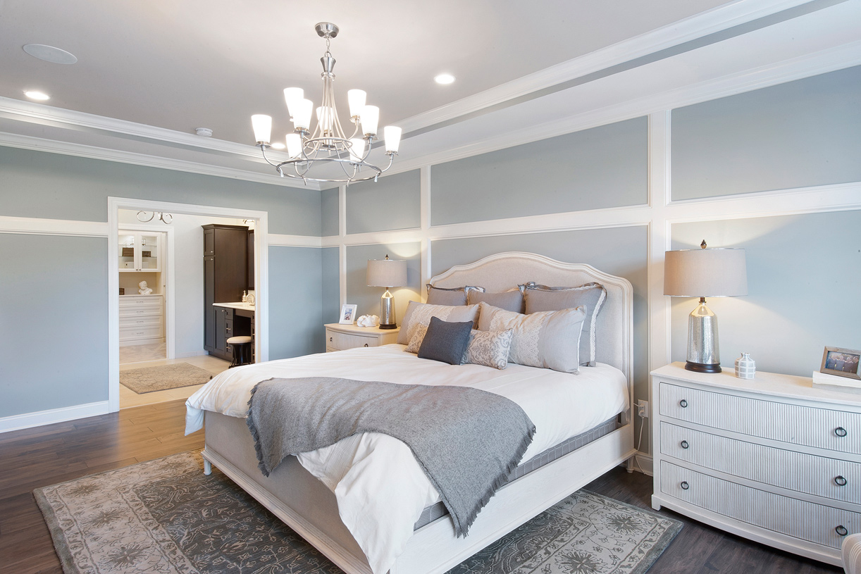 The large primary bedroom suite offers a large bath and impressive closet space