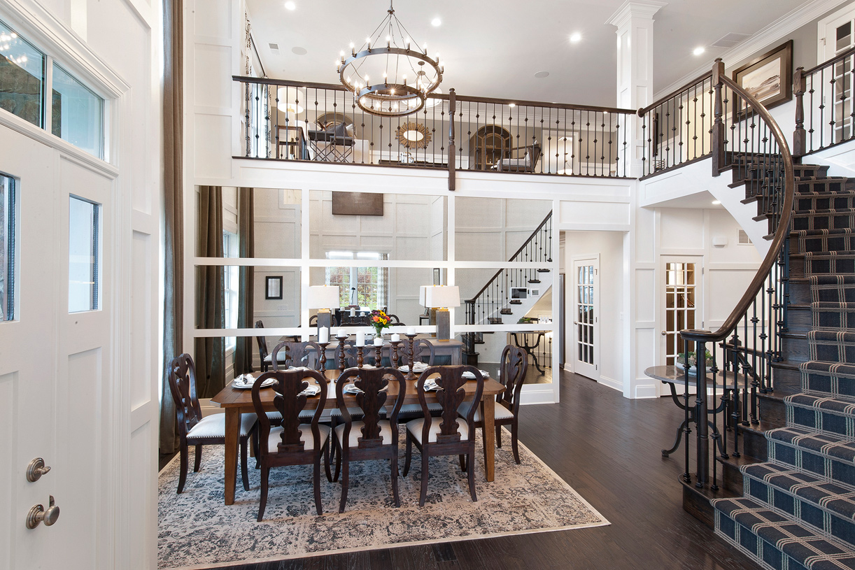A glamorous curved staircase welcomes you home