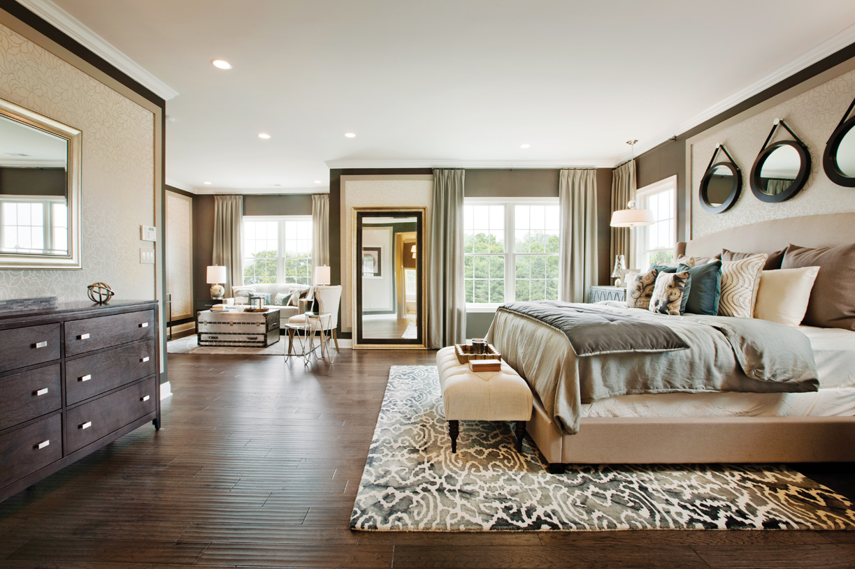 Luxurious primary bedroom suites with private retreats and multiple walk-in closets