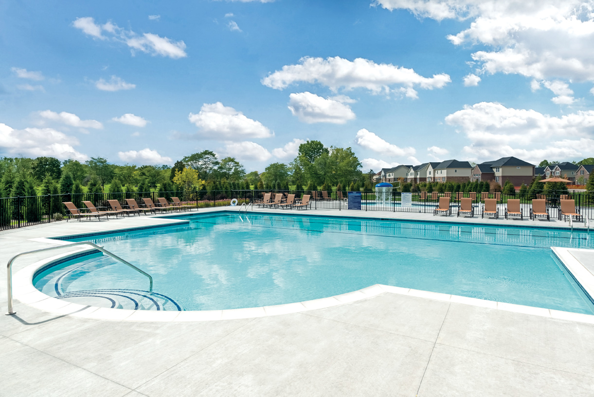 Lap pool and separate gated children's pool with zero entry and splash fountain