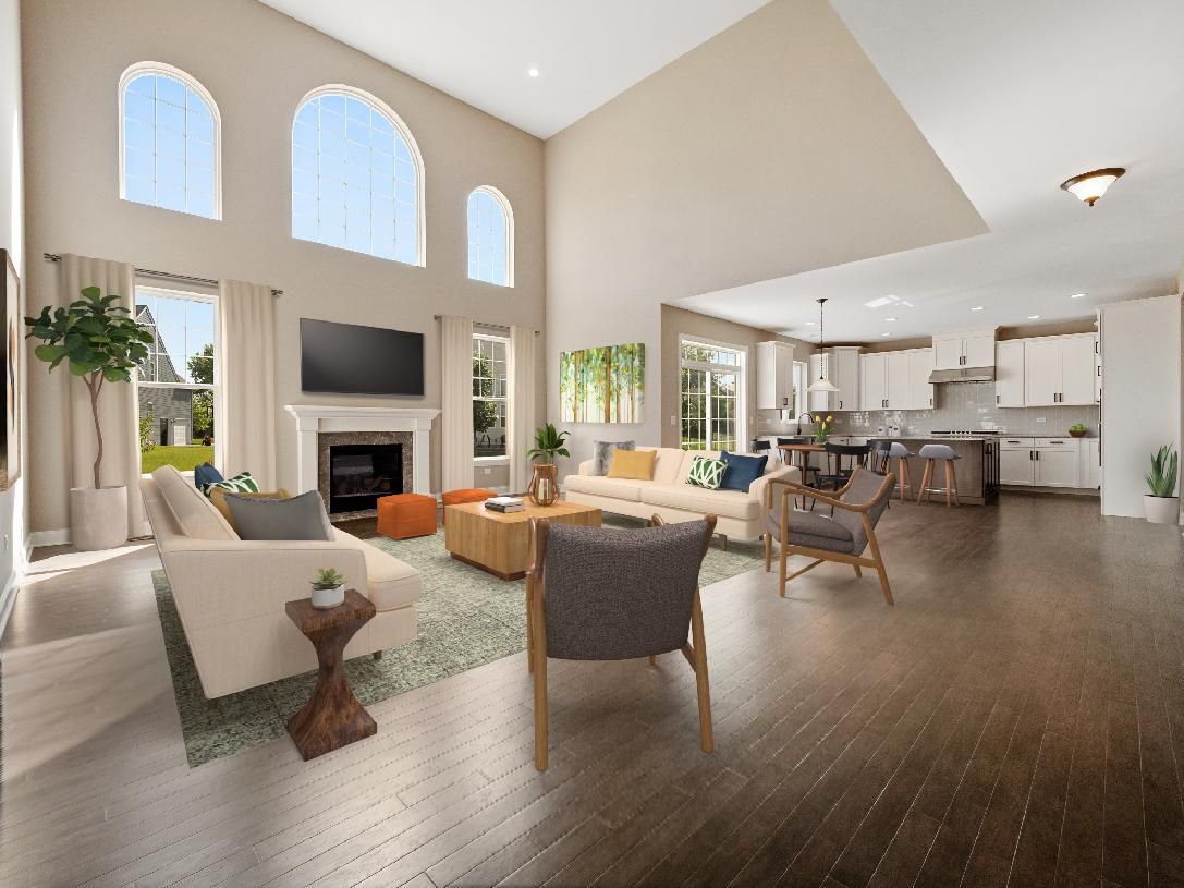 Stunning two-story family room shown with optional fireplace