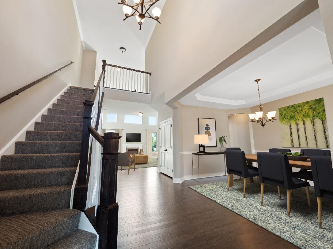 Impressive two-story foyer opens to formal dining room
