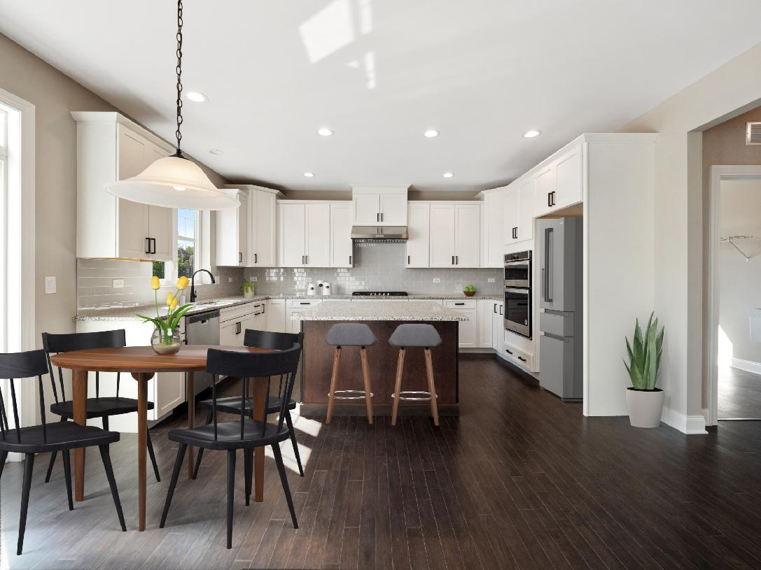 Well-appointed gourmet kitchen open to casual dining area
