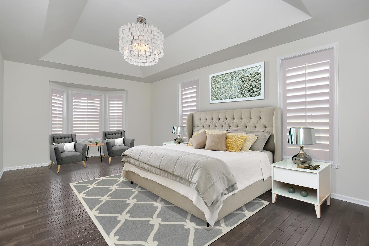 Luxurious first-floor primary bedroom suite with large walk-in closet