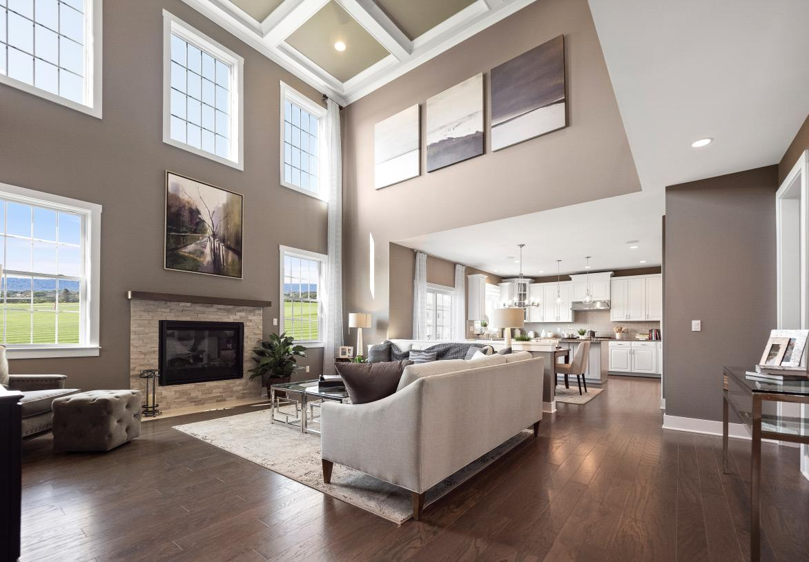 Stunning two-story great room with cozy fireplace