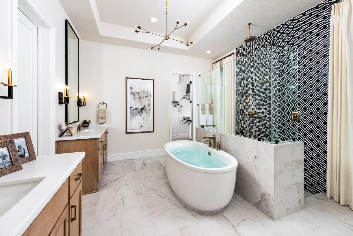 Primary bathroom with dual vanity and freestanding tub