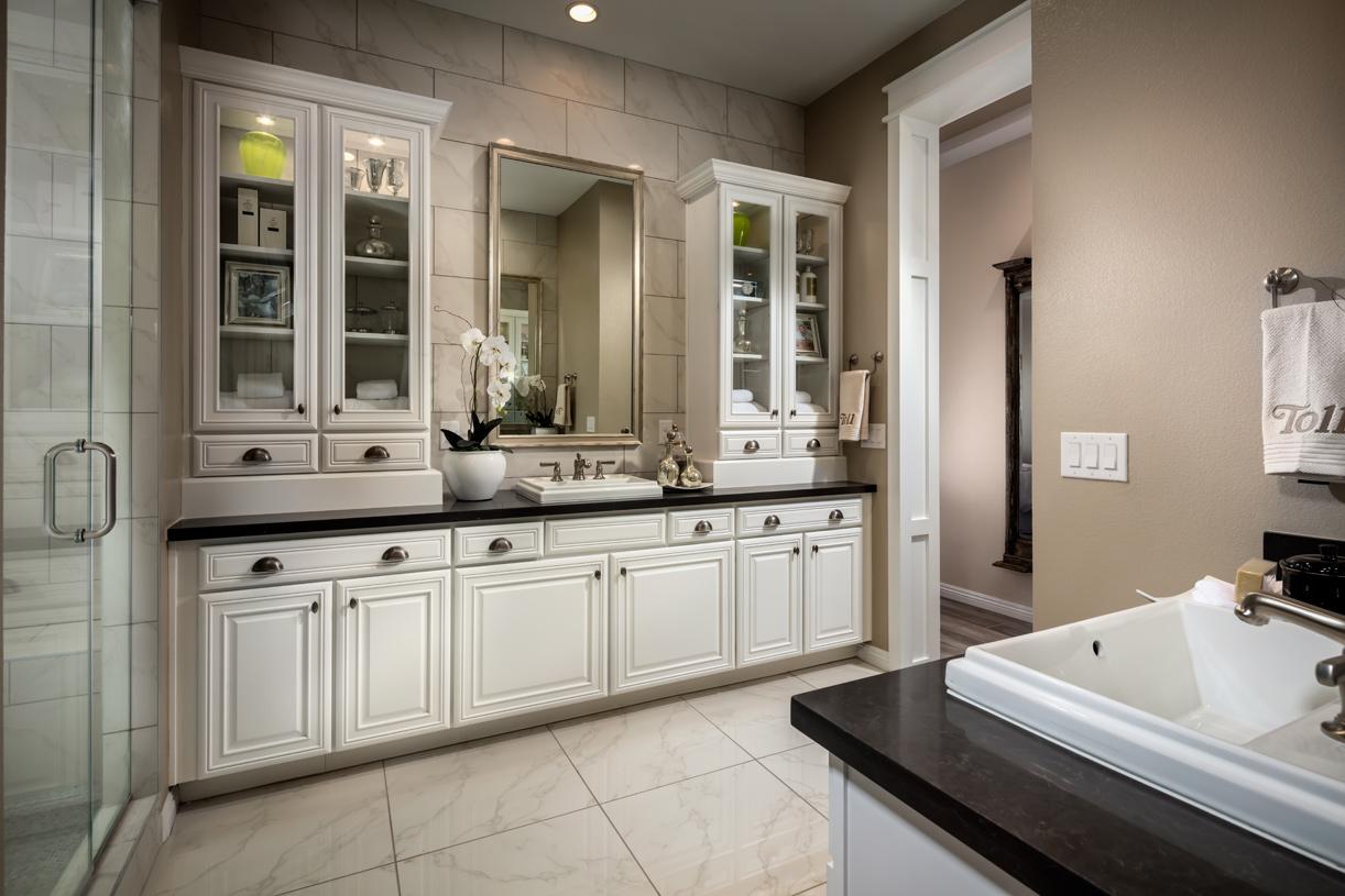 Luxe primary bathroom with dual vanities
