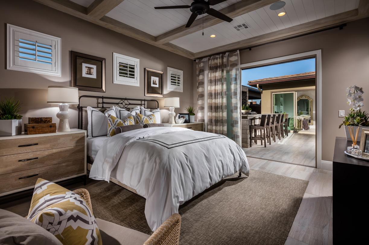 Generous primary bedroom suite with doors to outdoor area
