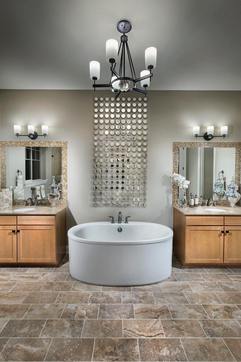Bancroft primary bathroom with freestanding tub and dual vanity
