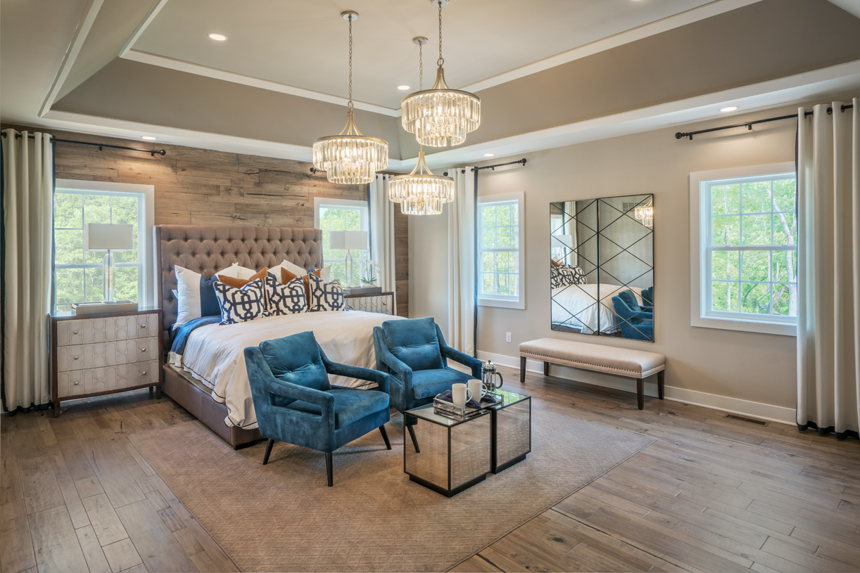 Luxurious primary bedroom suites with large walk-in closets and private retreats
