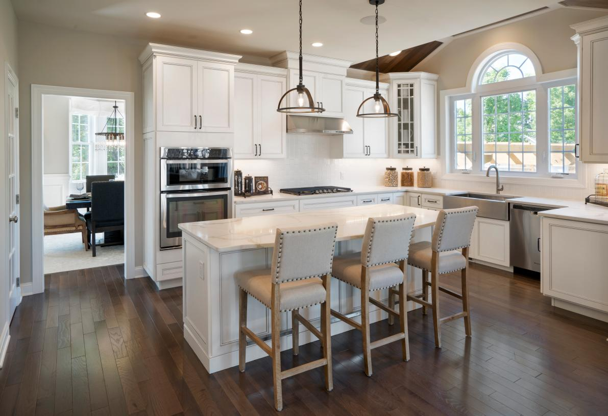 Well-appointed kitchen includes Whirlpool® stainless steel appliances, Kohler® faucets, 42-inch wall cabinets, granite countertops, ceramic tile backsplash, and more