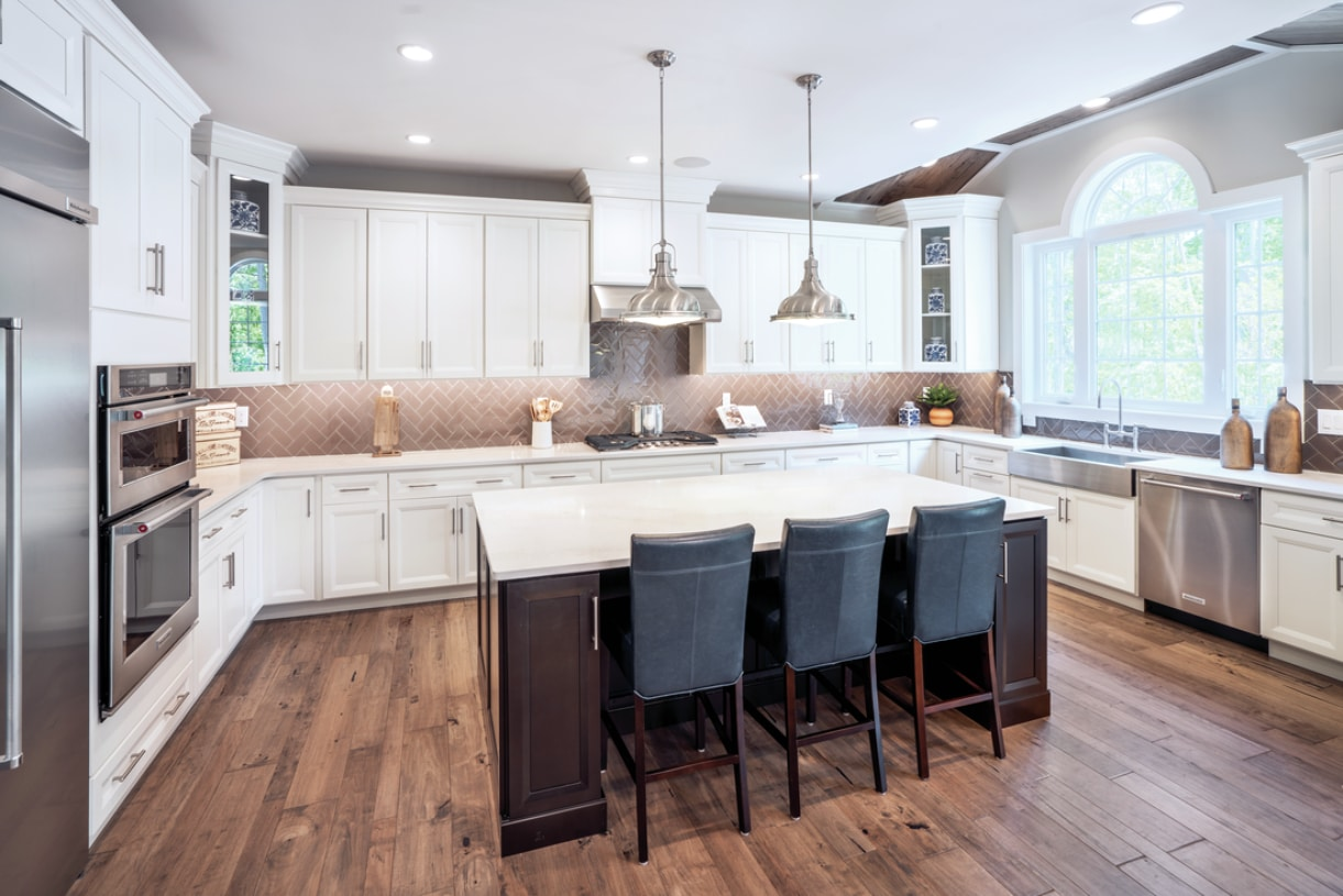 Gourmet kitchen includes walk-in pantry, Whirlpool® stainless steel appliances, granite countertops, hardwood flooring, and more