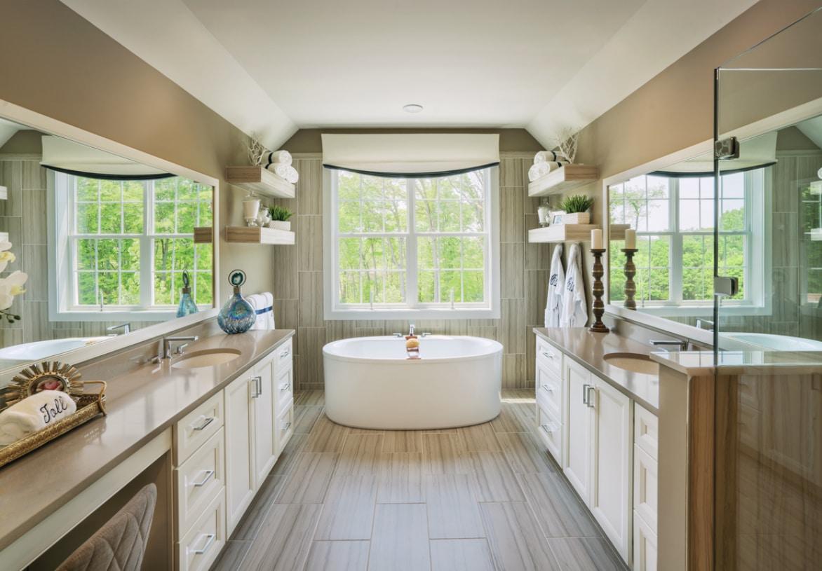 Lavish primary bath shown with alternate primary suite option