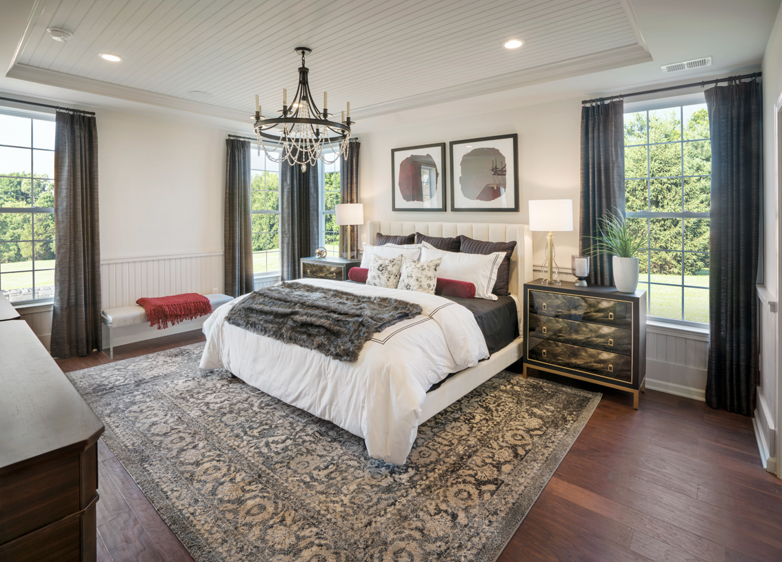 Luxurious primary bedroom suite in the Stonewyck