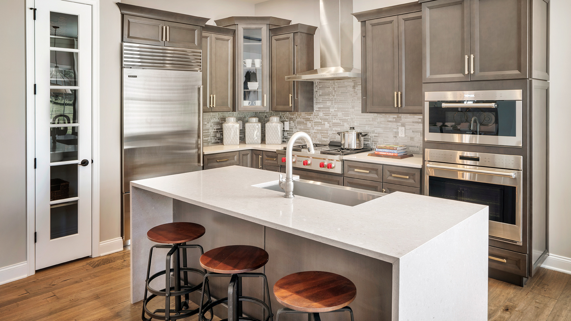 Well-appointed kitchen overlooks great room, a layout perfect for entertaining