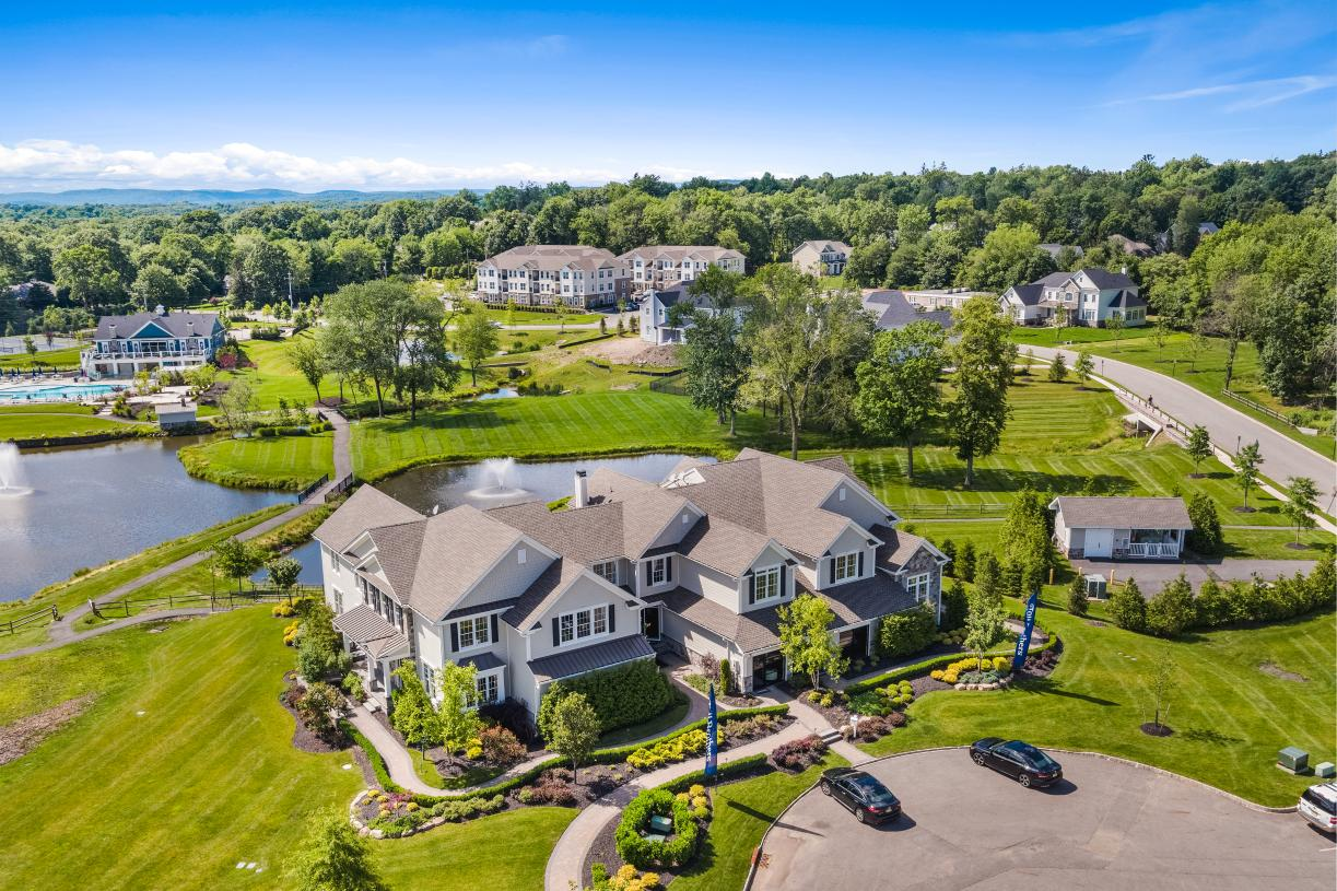 Aerial view of our model homes and scenic location with clubhouse in the distance