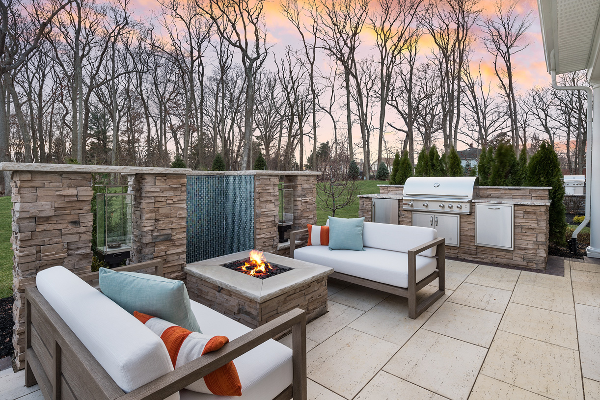The patio offers prime views of the beautiful wooded setting