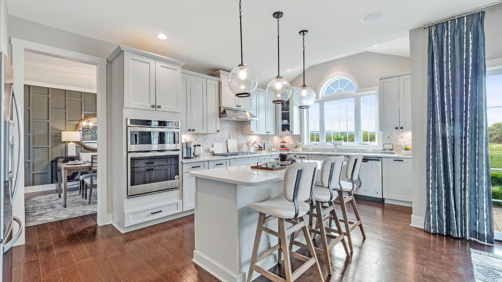 Beautiful open kitchens with center islands, granite countertops and stainless steel appliances