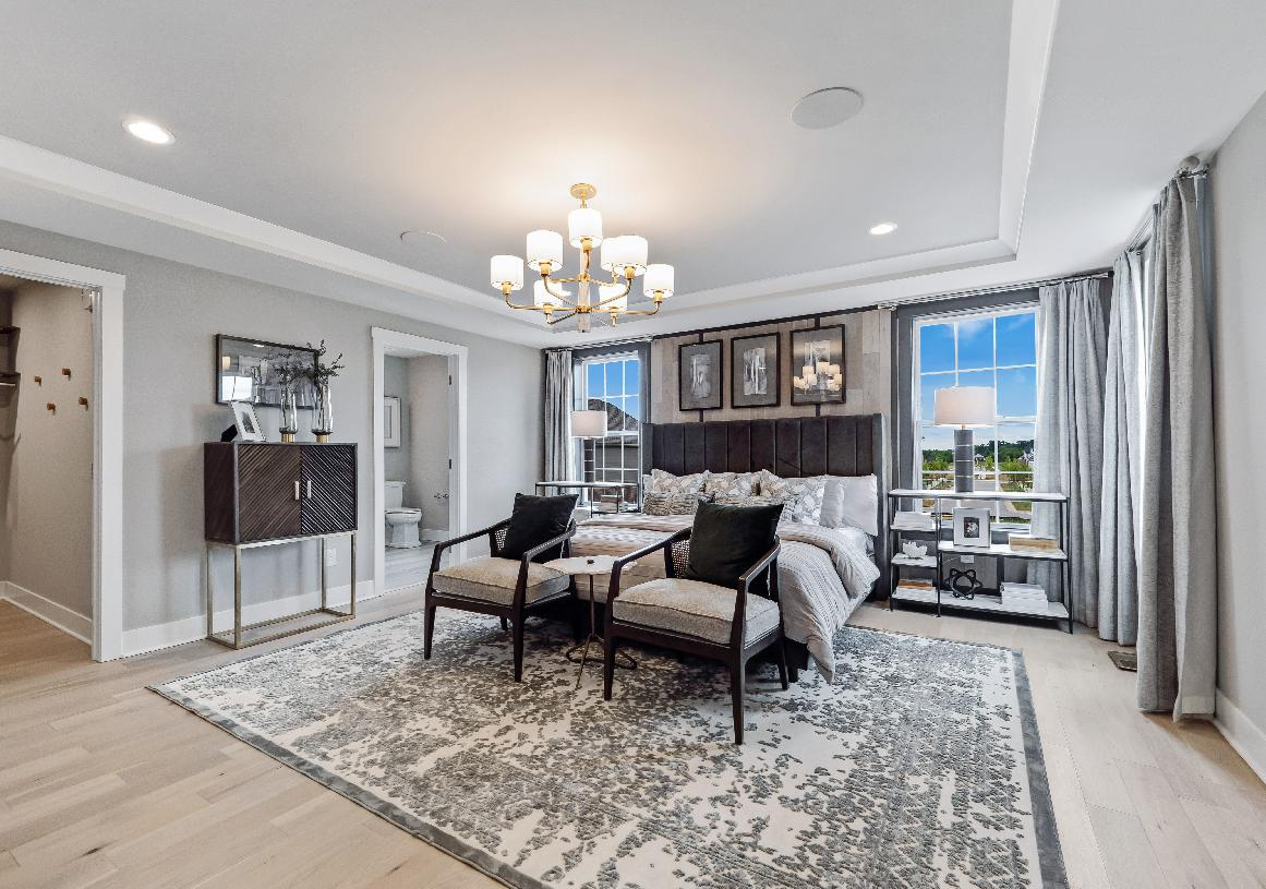 Luxurious primary bedroom suites with large walk-in closets