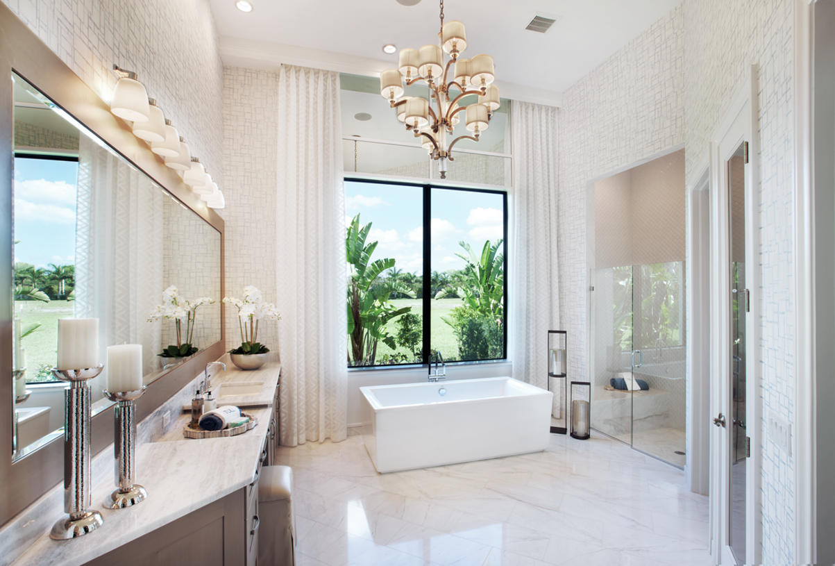 Spa-inspired primary bathroom with oversized free-standing soak tub