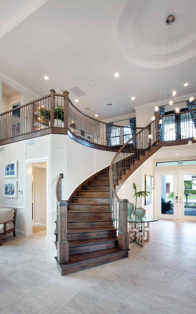 Dramatic two-story foyer & grand staircase