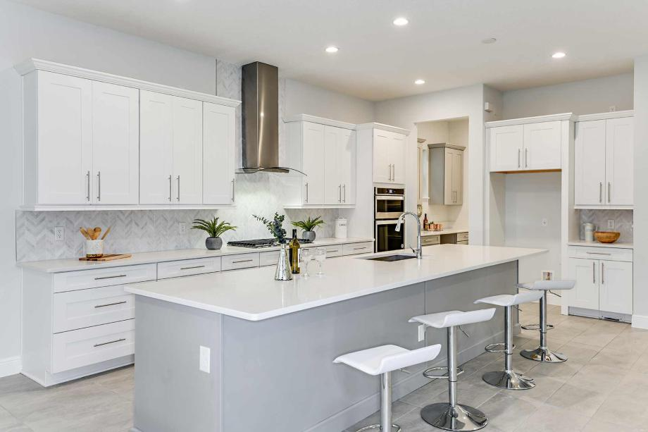 Gourmet kitchen with oversized center island and breakfast bar