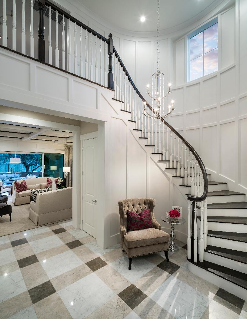 Elegant foyer with curved staircase